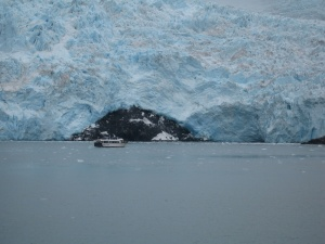 Small 100 foot ship with giant iceberg. STGrimes