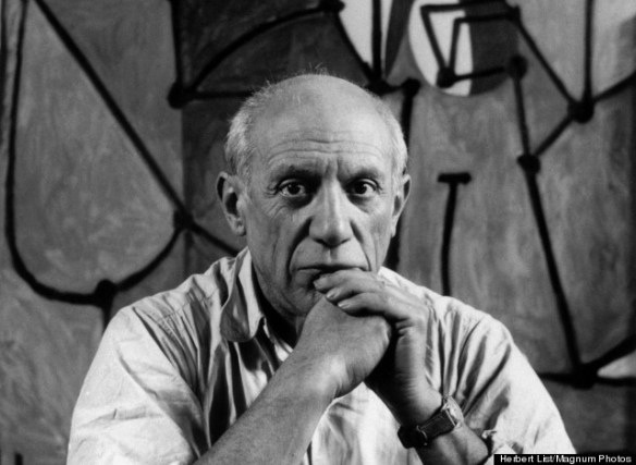 Pablo Picasso in front of the kitchen, photo by Herbert List